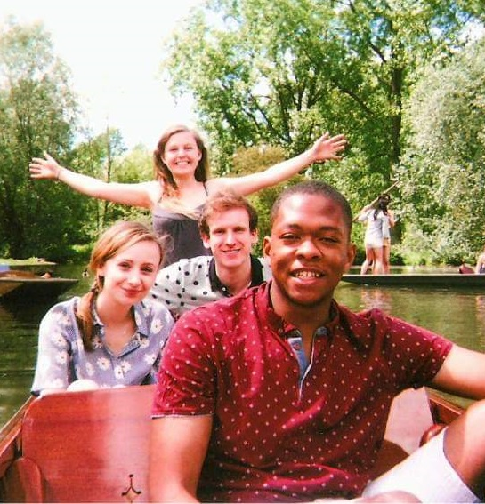 Four students punting on the river - Ashleigh Ainsley is at the front of the boat