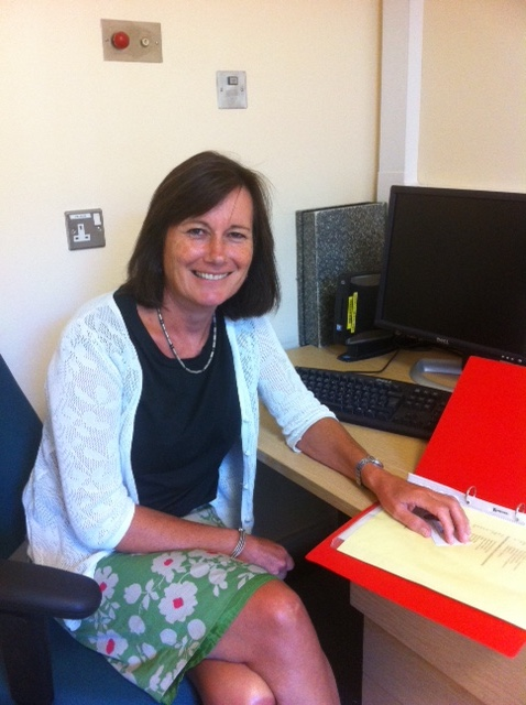 Lucy Johnstone sat at a desk with an open file
