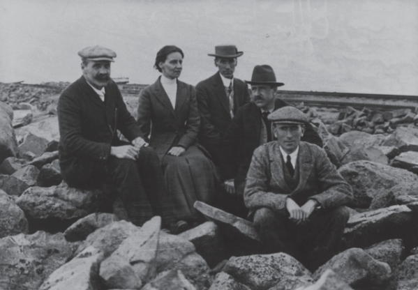 Mabel Fitzgerald as part of a group of five people, sat in a boulder field