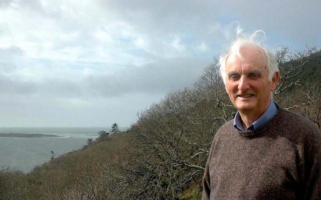 Sir John Houghton in the garden of his home at Aberdyfi overlooking the Dyfi estuary