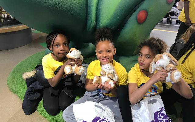 The young participants in the ExVac scheme holding cuddly rabbit toys
