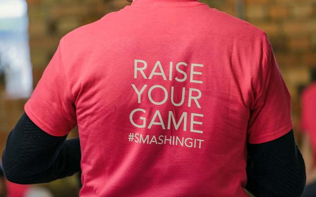 The back of an Oxford Foundry t-shirt, which reads 'Raise your game #smashingit'
