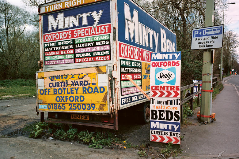 Photo of a 'Minty Beds' billboard covered lorry in Oxford's Botley Road