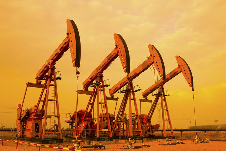 Oil Pumps depicted against a sunset sky