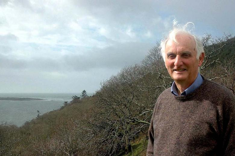 Sir John Houghton in the garden of his home at Aberdyfi overlooking the Dyfi estuary