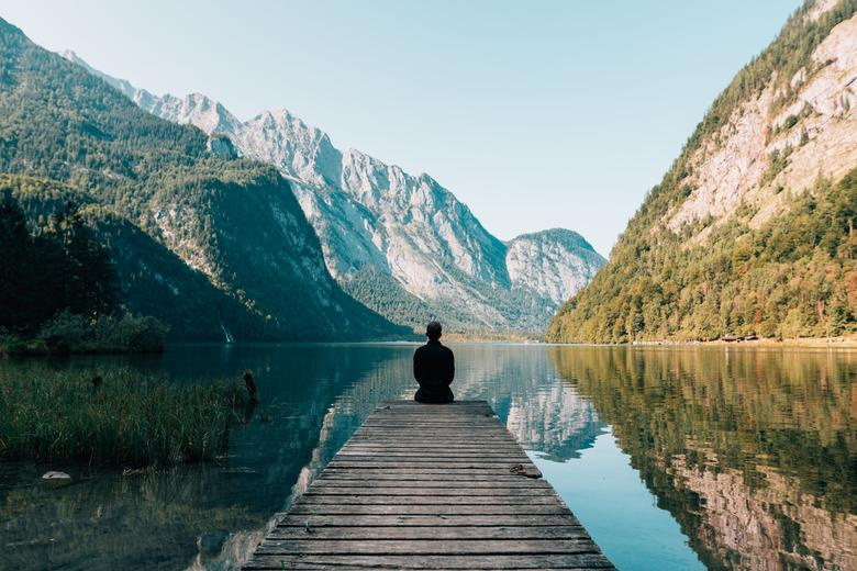 Mindfulness of man sitting by a lake