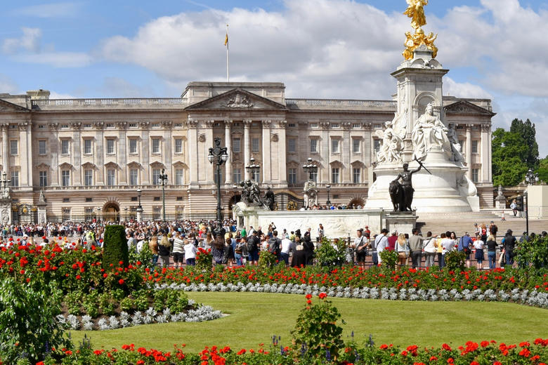 Buckingham Palace - with flower beds and the Queen Victoria Memorial in the foreground