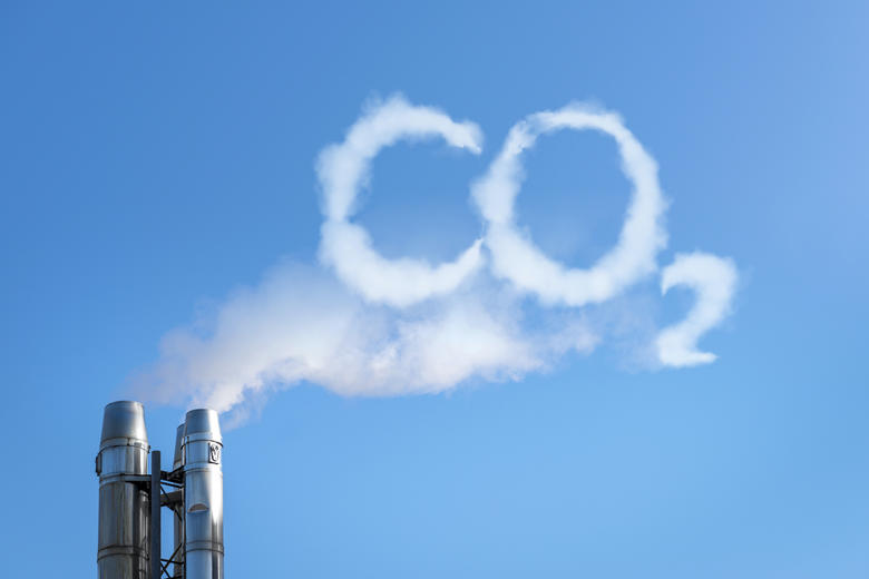 Smoke emission from a chimney that spells 'CO2'