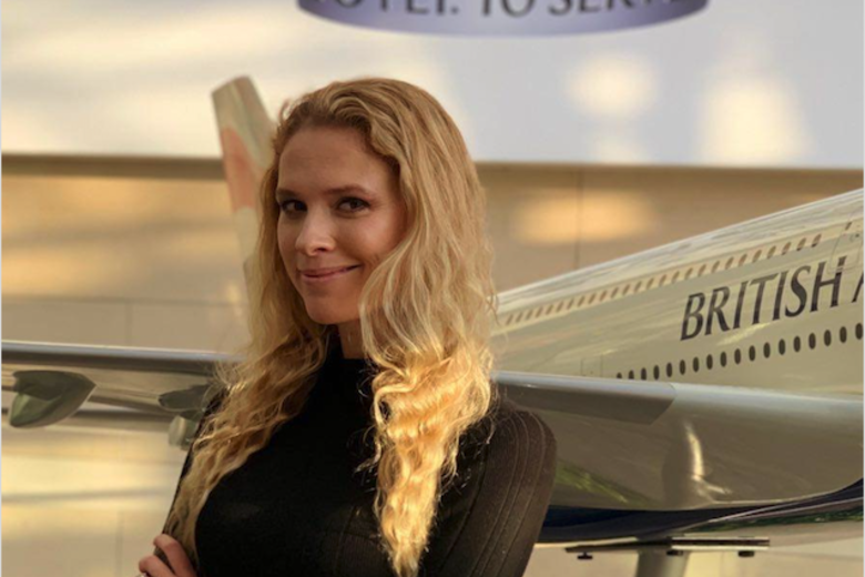 Irra Ariella Khi stood in front of a model of a British Airways plane