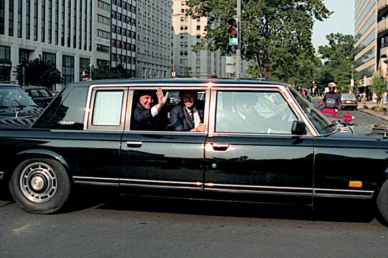Russian President Mikhail Gorbachev waves from his limousine. Washington DC, USA. 31st May, 1990