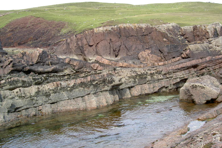 A picture of a rock formation, showing the different rock types which indicate the meteor strike location