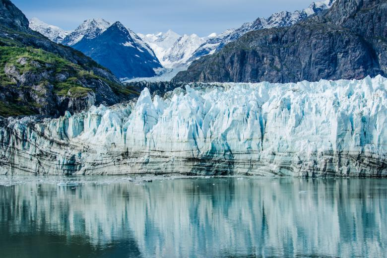 Close-up of Margerie Glacier in Glacier Bay National Park and Preserve in Southeast Alaska which is twenty-one miles long and one mile wide with layers of rock debris mixed with ice
