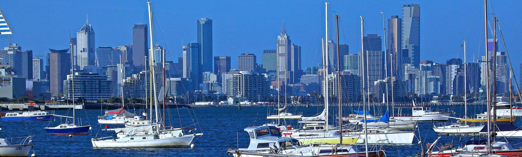 The skyline of Melbourne, Australia, with sailing boats in the foreground