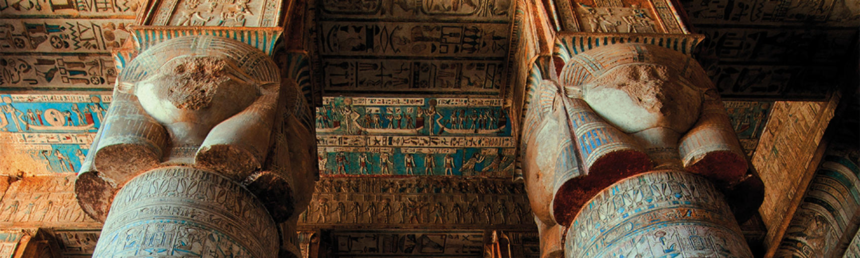 Looking up to the top of columns in an ancient egyptian temple