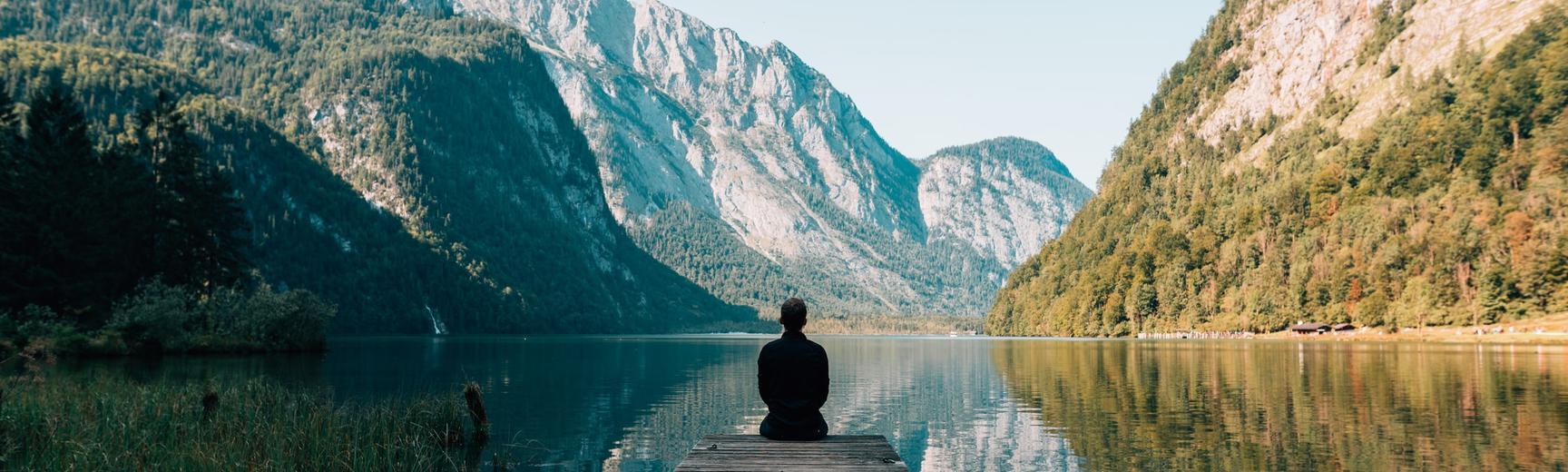 Mindfulness of man sitting by a lake