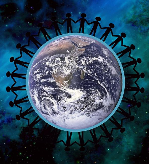 A circle of stick figures connecting hands stood on the earth as seen from space