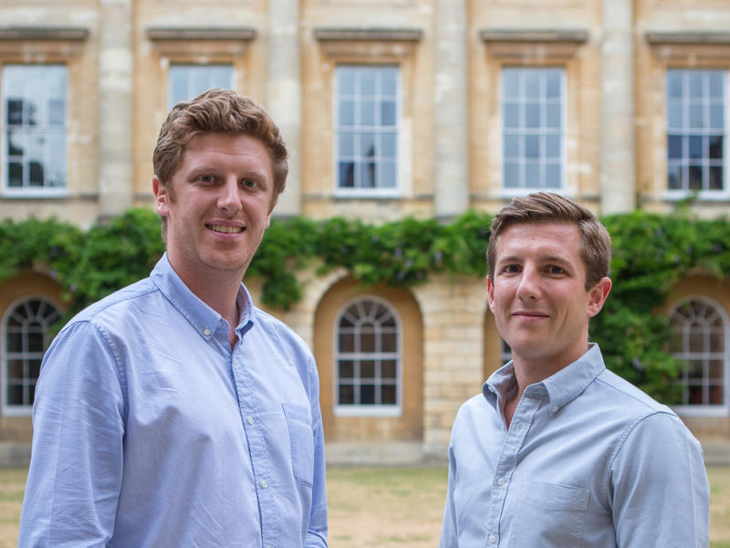 Harry Hortyn and Robert Phipps stood in a college quad
