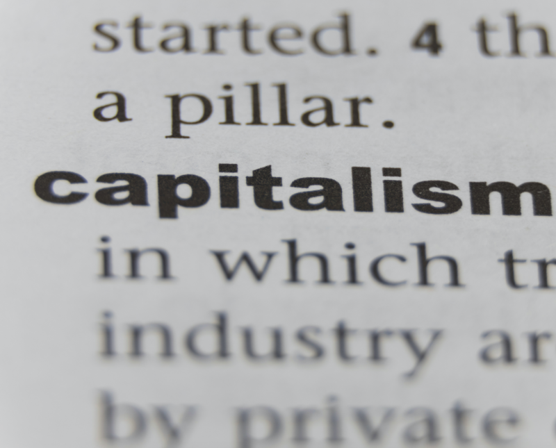 A close-up picture of the word 'capitalism' in a dictionary