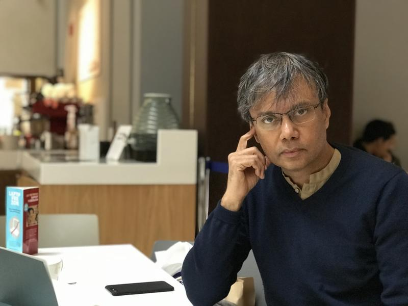 Amit Chaudhuri sat at a table in the Weston Library