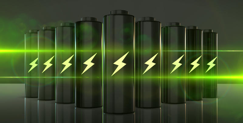 A row of batteries, with a lightning bolt symbol on each, and a bright green light illuminating the scene