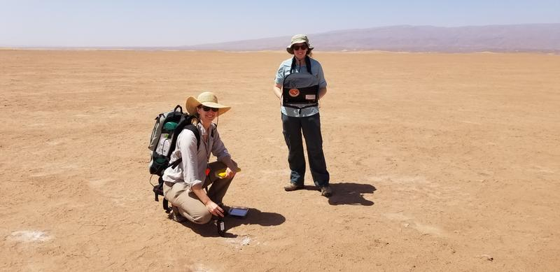 Bethany Elhmann and a colleague in the middle of a desert