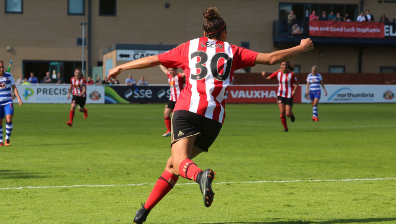 Beverly Leon, playing for Sunderland, celebrating a goal, with team mates running towards her
