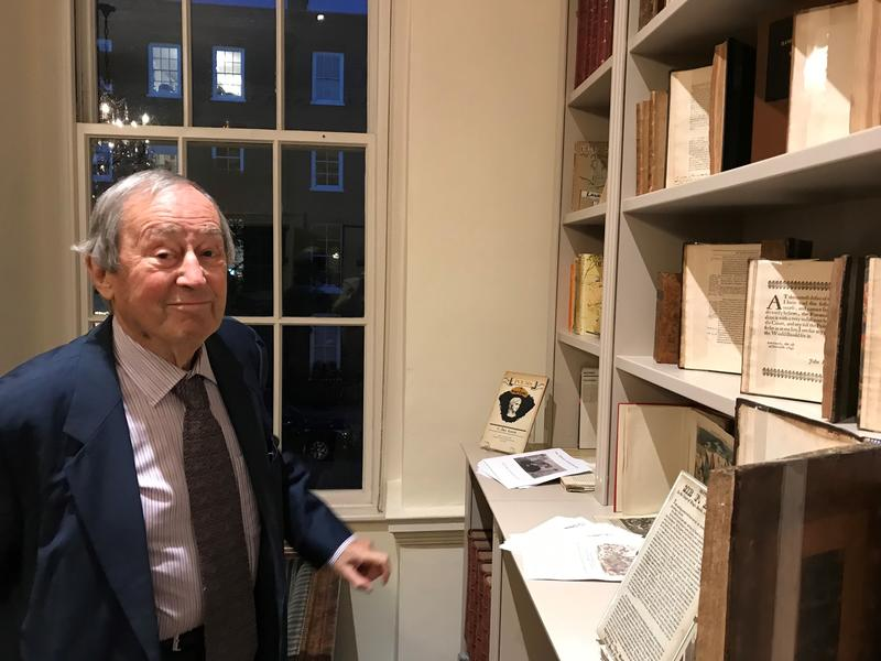 Sir Geoffrey Bindman, stood next to some of his books and prints