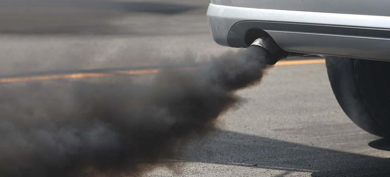 A car emitting a large amount of black smoke from its exhaust
