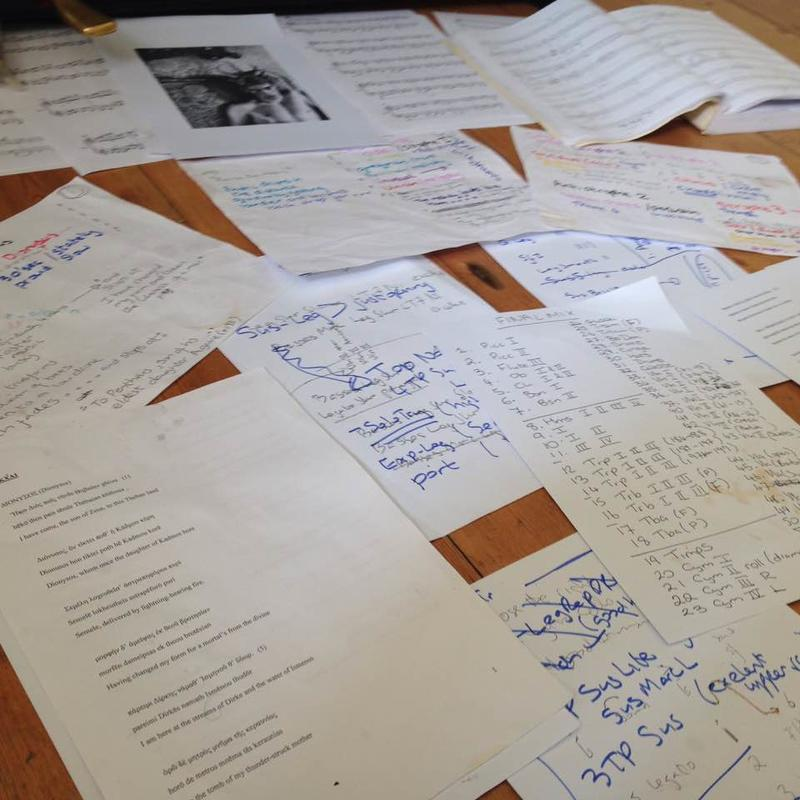 A table covered in pieces of paper with notes on musical production, composition ideas and lyrics