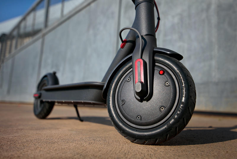 Close-up shot of an electric scooter front wheel