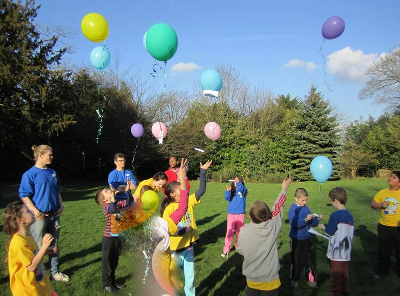 Children releasing balloons in to the air