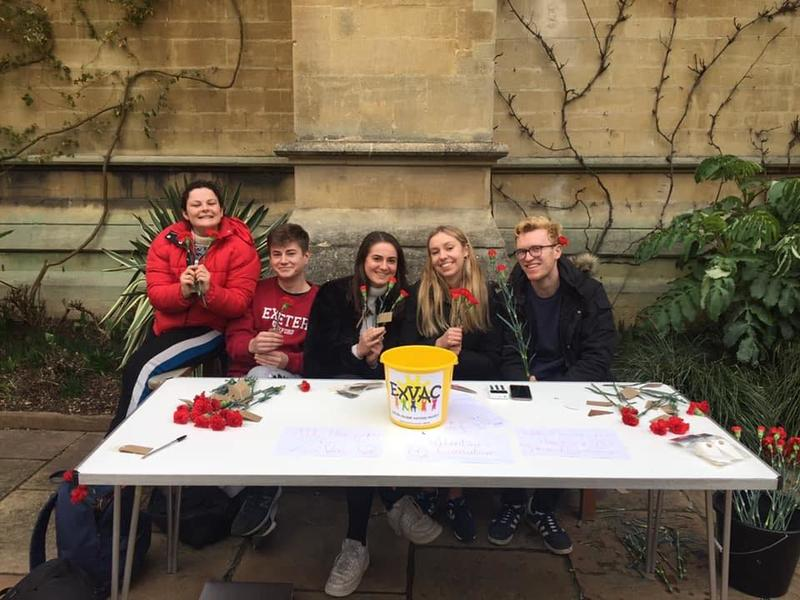 Five Exeter College students sat behind a table, selling roses to raise money