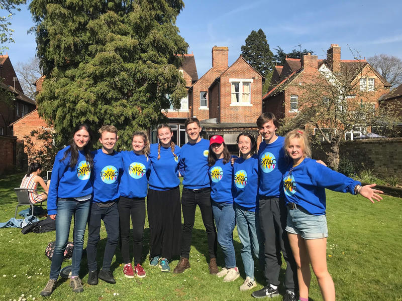 Nine Exeter College students in a group photo, all wearing ExVac sweatshirts
