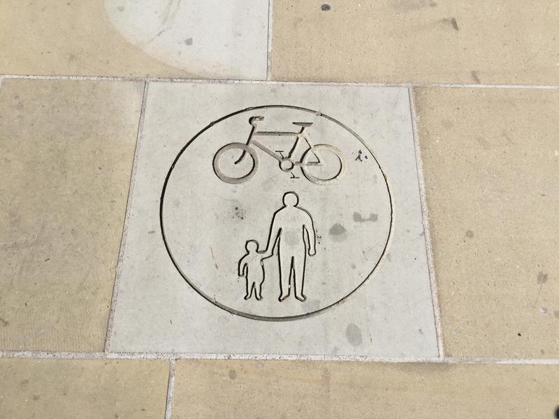 A sign on the pavement of Frideswide Square, indicating shared cycle and pedestrian use