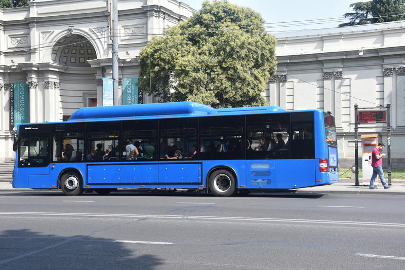 A gas-powered bus on a street in Tblisi