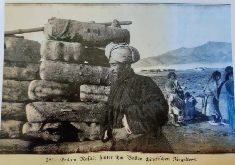 A picture of Ghulam Rasool Galwan in 1907 with bales of tea destined for Leh