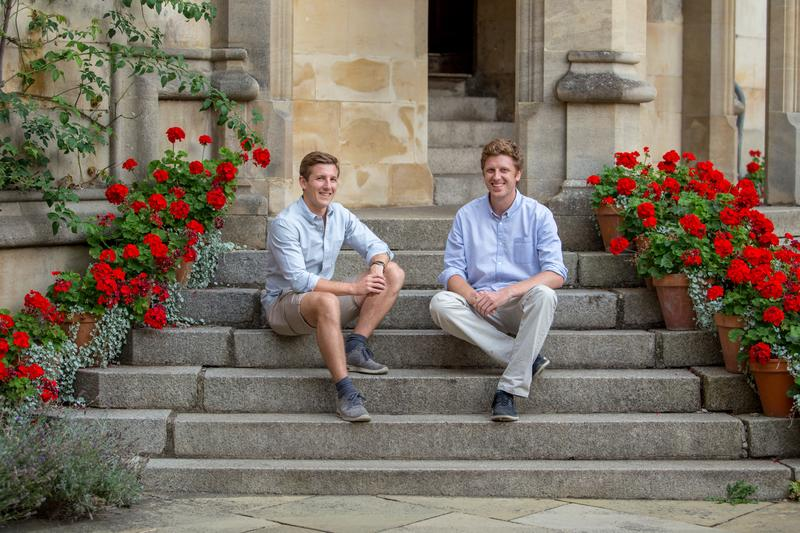 Harry Hortyn and Robert Phipps sat outside on a flight of steps