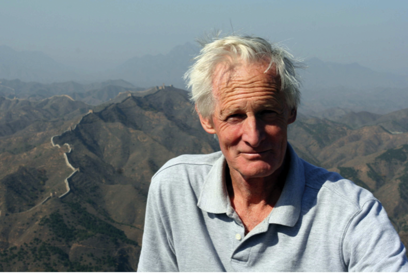 John Man, with an arid mountain range behind him