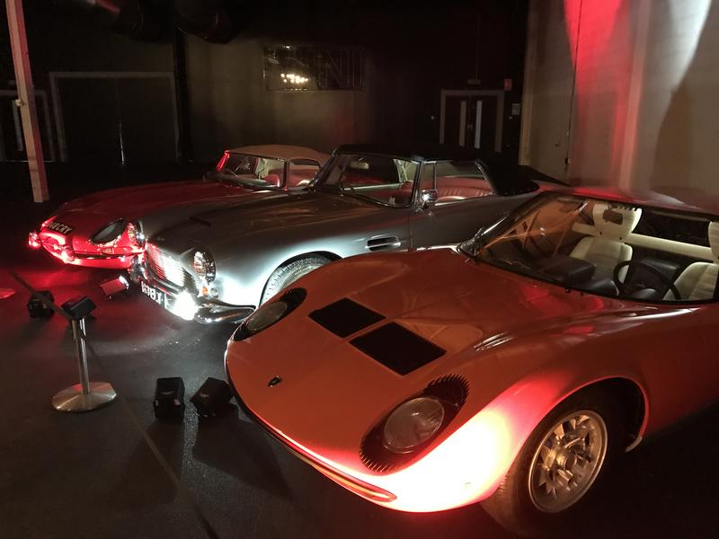 The E-Type, DB 4 and Miura on display indoors