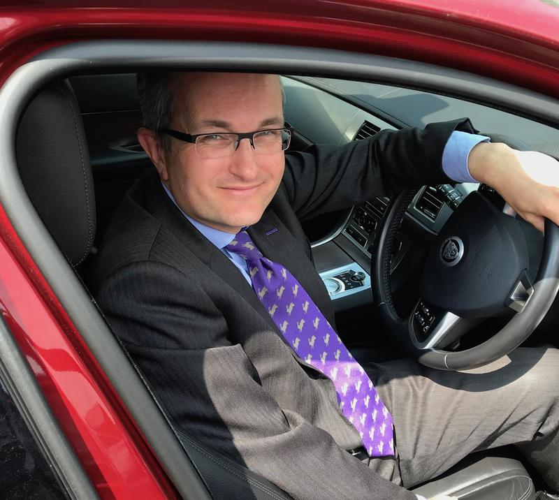 Nick Molden sat in the driver's seat of a Jaguar