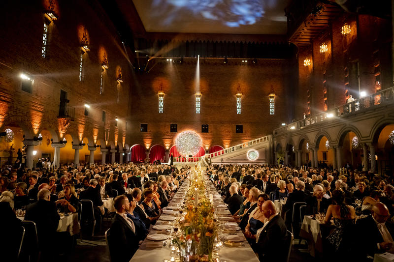 The 2019 Nobel Banquet - a large banquet in a grand hall, with a stage visible at the end of the room