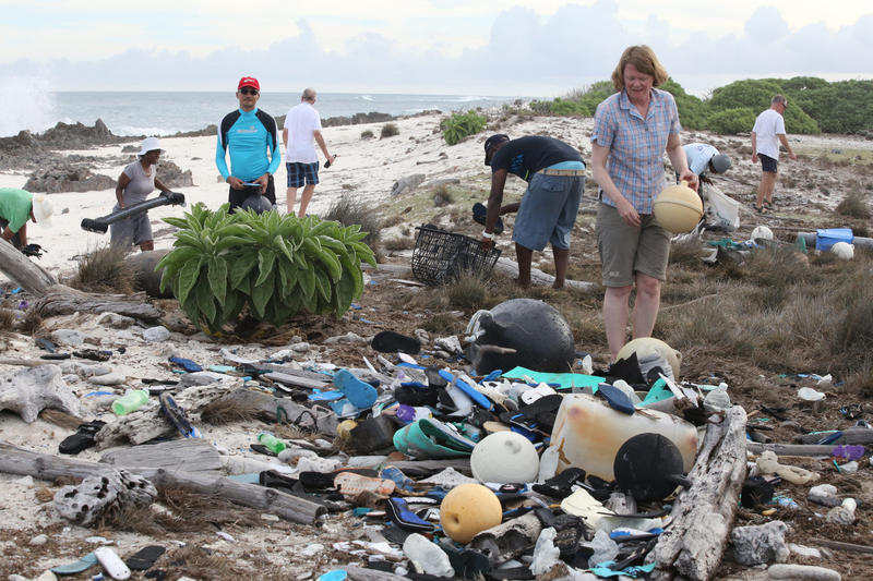 Volunteers working to clear up plastic and other debris on a beach