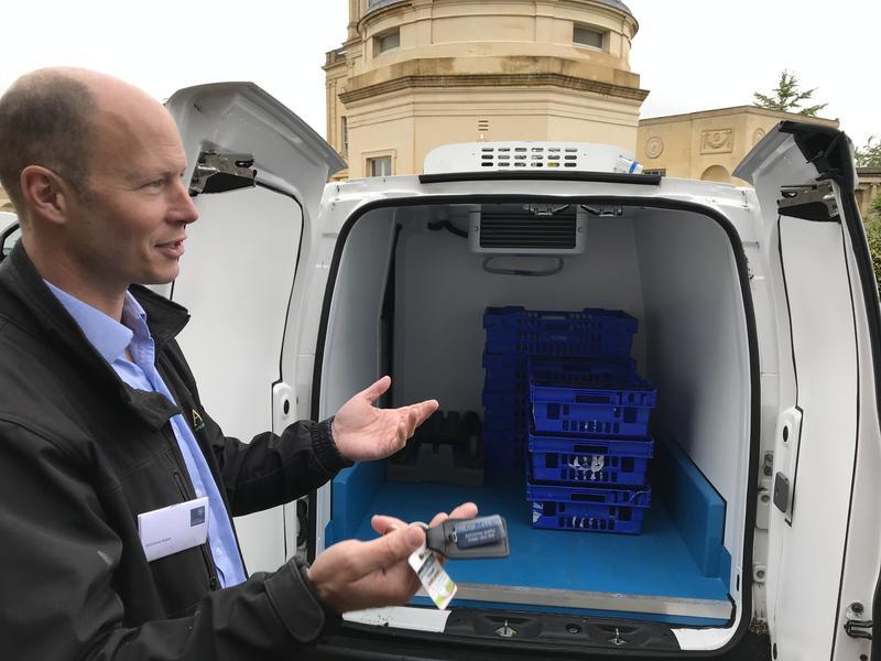 Matthew Alden showing the inside of his refrigerated, electric van