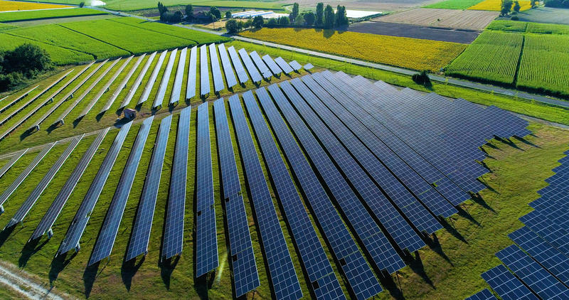 An aerial view of a field of solar panels