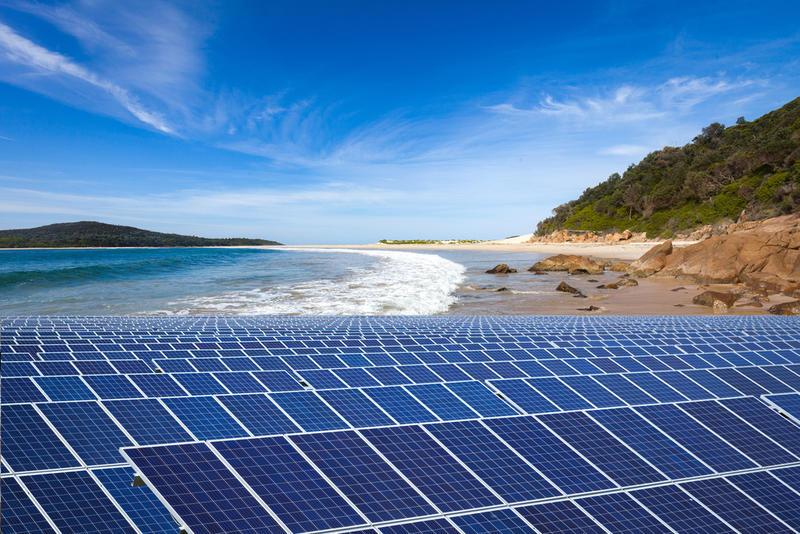 A bank of solar panels on a beach