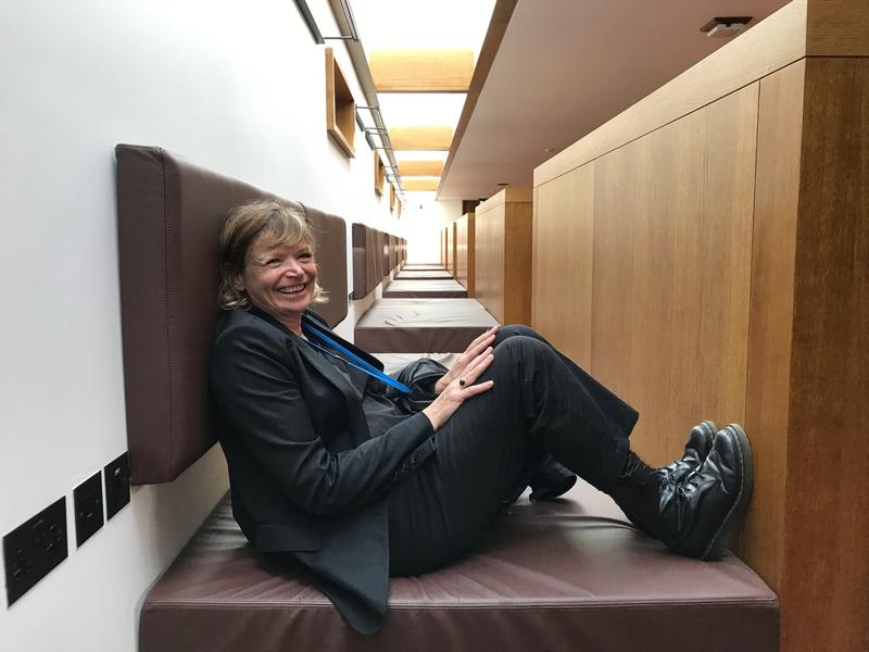 Claire Wright sitting on one of the study 'beds' in the library