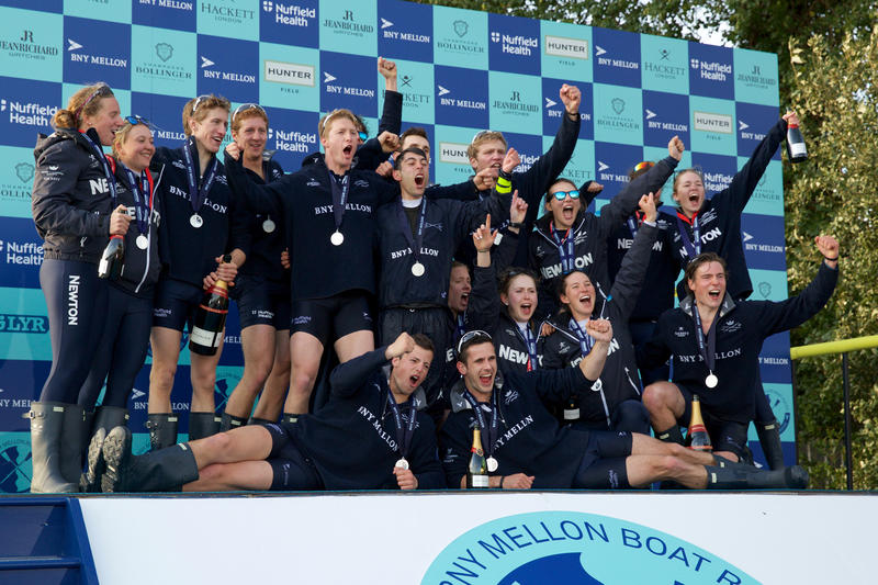 The mens and womens crews celebrating victory in the 2015 boat races