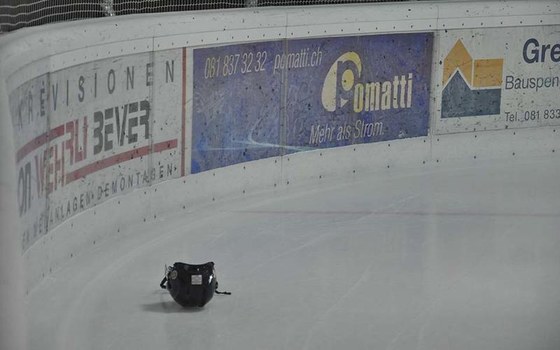 An ice hockey helmet on an ice rink