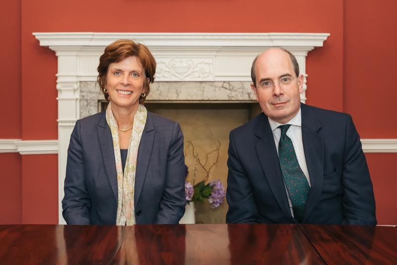 Oxford University Vice-Chancellor Professor Louise Richardson, and Legal and General Chairman Sir John Kingman, seated at a table