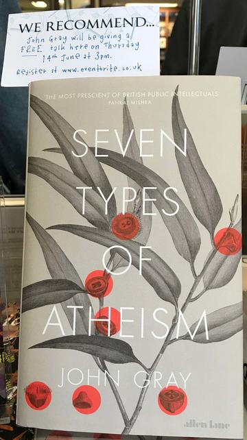 A window display with the cover of 'Seven types of atheism' by John Gray beneath a note giving details of John's talk on the book